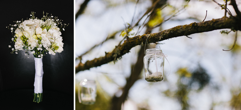 White wedding flowers roses and candle in jar hanging from tree