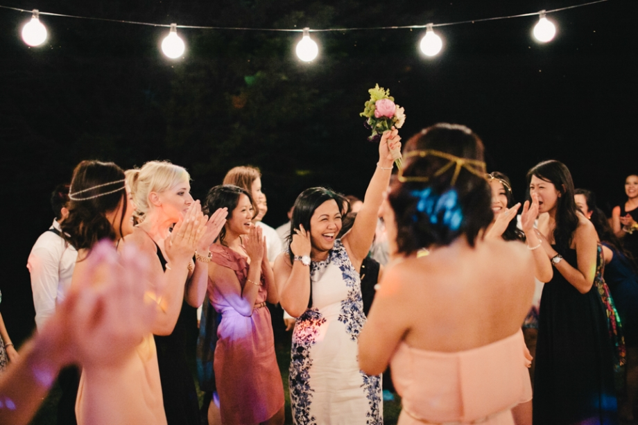 Bouquet toss outside under the stars