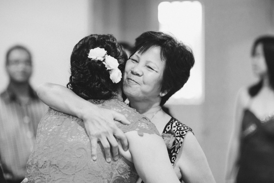 Mother of the groom hugs the bride