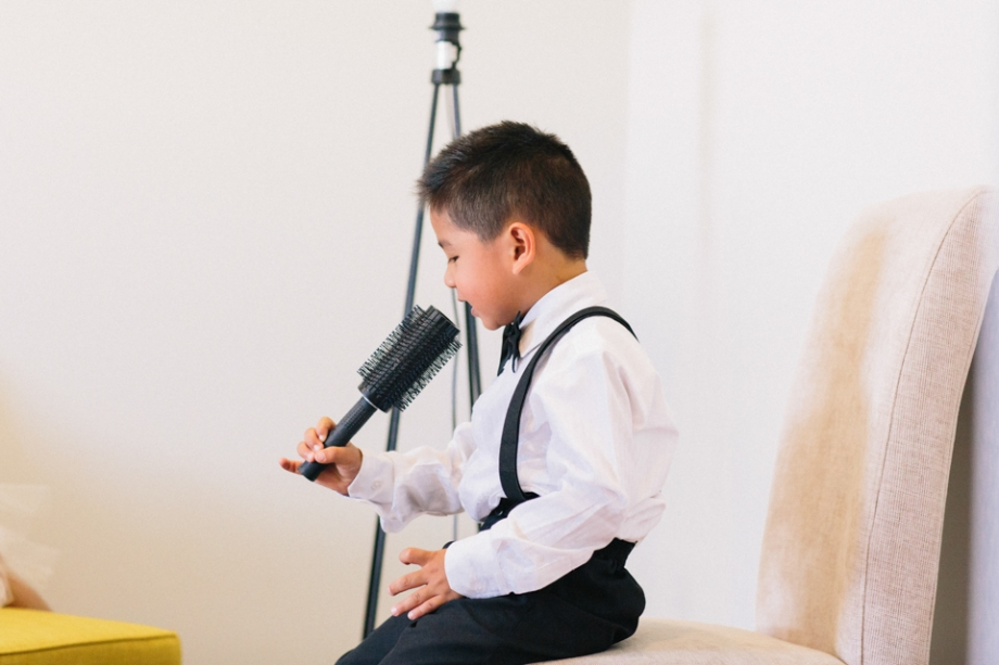 Page boy having fun at a wedding singing