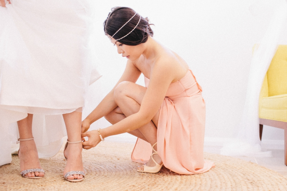 Putting shoes on wedding getting ready