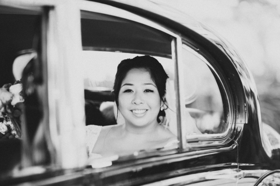 Bride arriving in car black and white photography