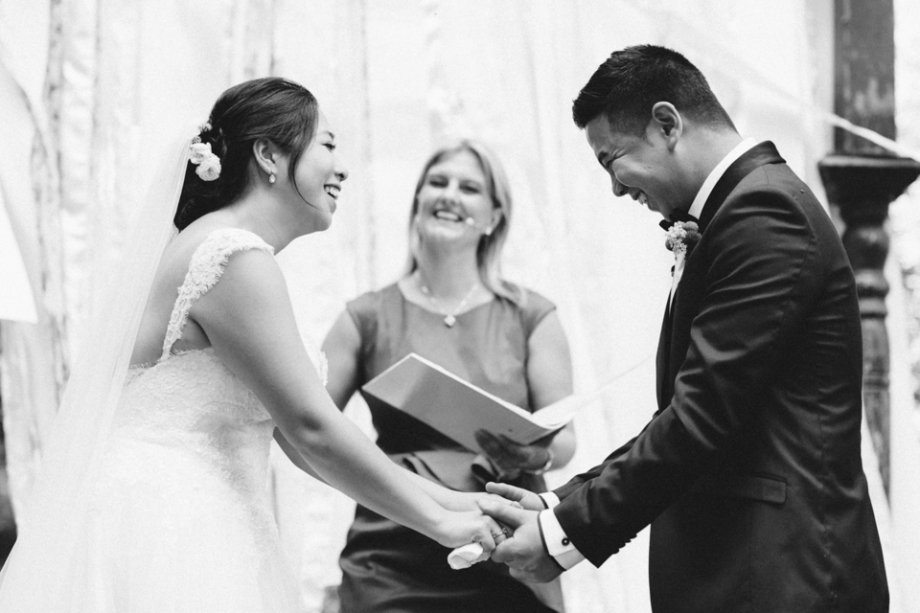 Bride and groom laughing during ceremony wedding photography
