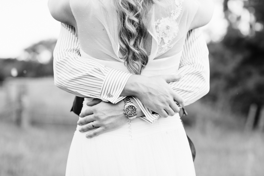 Bride and groom with wrist watch in black and white