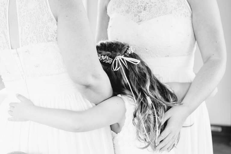flower girl hugging bridesmaids Riversdale Wedding natural light black and white